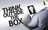 stock photo of thinking outside box  - Business man with the text Think Outside the Box in a concept image - JPG