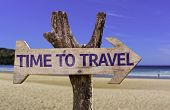 picture of encouraging  - Time to Travel wooden sign with a beach on background - JPG