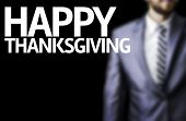 picture of thursday  - Business man with the text Happy Thanksgiving in a concept image - JPG