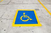 image of handicapped  - Handicapped symbol on parking space in blue - JPG