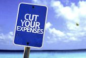 image of waste reduction  - Cut Your Expenses sign with a beach on background - JPG