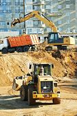 foto of boom-truck  - wheel loader and excavator machine loading dumper truck at construction area sand quarry - JPG