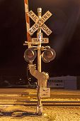 image of railroad-sign  - Railroad crossing by night with sign in kingman - JPG