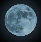 image of blue moon  - Blue Full moon isolated on a black sky - JPG