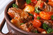 stock photo of stew pot  - stew in tomato sauce with vegetables and herbs in a pot macro - JPG