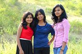 foto of three sisters  - Simple portrait of three sisters in outdoor