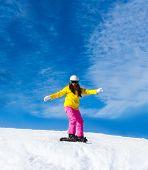 pic of snow-slide  - Snowboarder woman sliding down hill - JPG