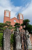stock photo of bomb  - Atomic bombed christian statues in front of Urakami Cathedral in Nagasaki, Japan.