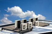 stock photo of hvac  - air condition outdoor unit on the roof with blue sky - JPG