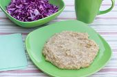 picture of porridge  - wheat porridge and cabbage salad in a plate on a wooden table - JPG