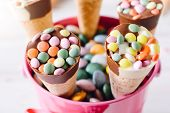 image of bonbon  - Sweet ice creams with colorful bonbons in the basketselective focus - JPG