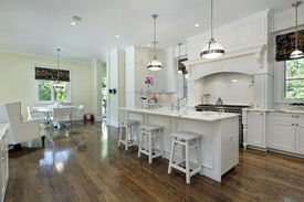 picture of light fixture  - Large kitchen in luxury home with white cabinetry - JPG