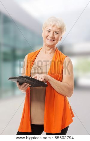 Old beautiful lady with tablet