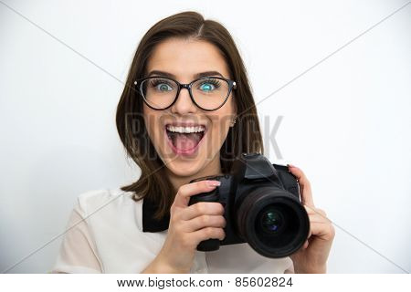 Surprised young attractive woman holding camera