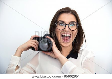 Surprised young funny woman holding camera