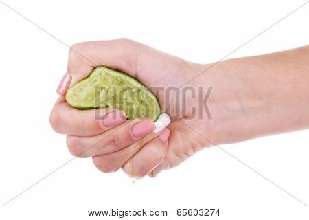 Female hand squeezing lime isolated on white