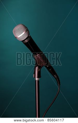 Microphone on stand on green background