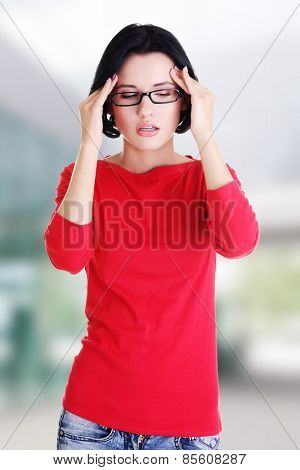 Young sad woman have headache
