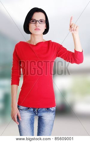 Young beautiful woman making choose on abstract screen