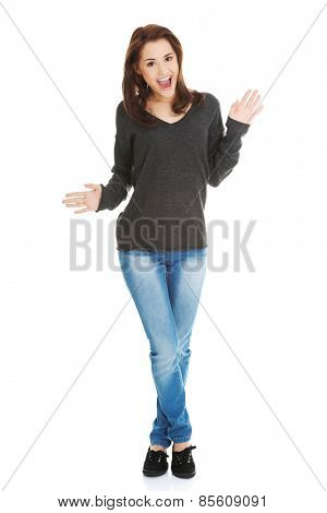 Young beautiful brunette woman cheering