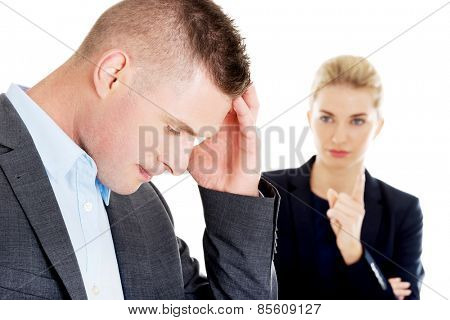 Young beautiful businesswoman reprimend her partner