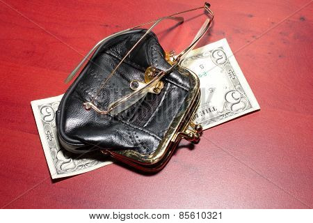 purse, glasses,dollars