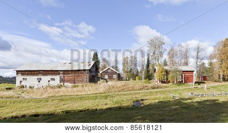 Wooden buildings in rural countryside.