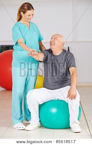 Old man during rehab in physiotherapy in a nursing home