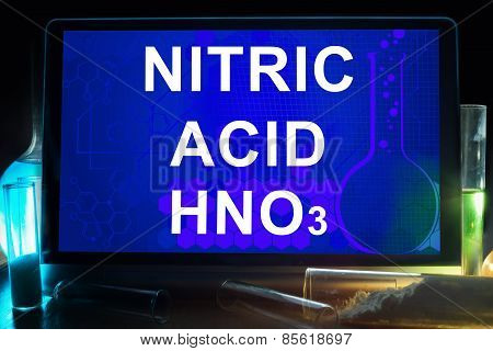 Tablet with chemical formula of  nitric acid.