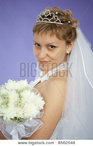 Portrait Of Beautiful Young Woman - Bride On Violet