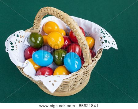 Colorful Easter eggs inside straw wicker