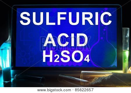 Tablet with chemical formula of sulfuric acid.