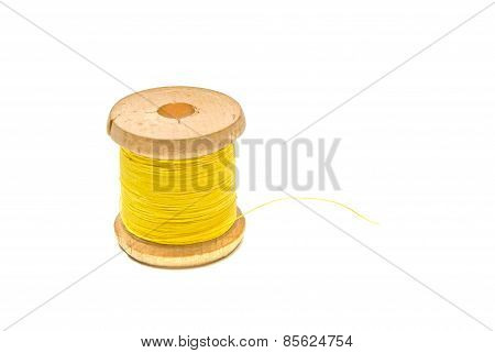 Wooden Spool Of Yellow Thread