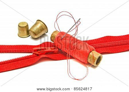 Zipper, Thimble And Spool Of Thread