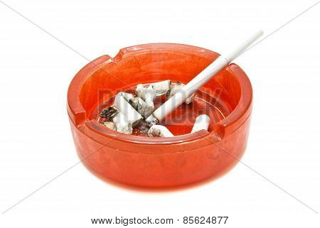 Butts And Cigarette In Red Ashtray