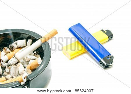 Lighters And Cigarette In Ashtray