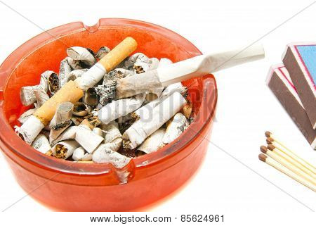 Matches, Butts And Cigarette On White