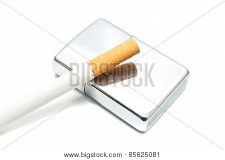 Metal Lighter And Cigarette On White