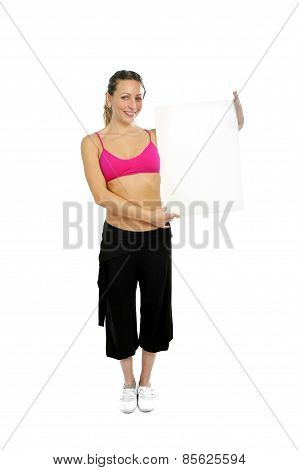 Sexy Attractive Woman In Sport Pants And Gym Bra Holding Blank Billboard Card With Copy Space