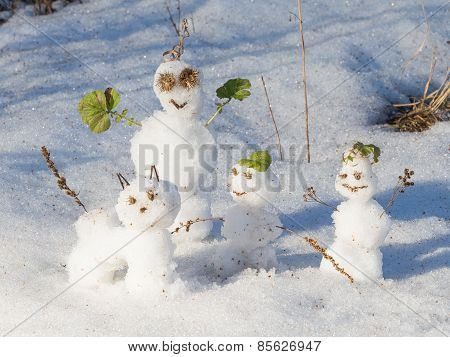 Three Funny Snowmen And Snow Cat