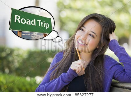 Pensive Young Woman with Thought Bubble of Road Trip Green Road Sign.