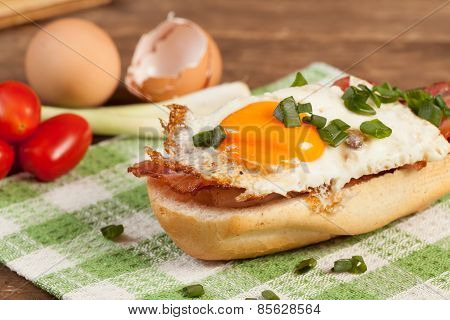 Sandwich With A Fried Egg And Bacon
