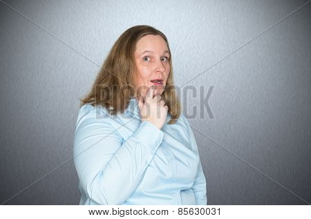 A business woman is surprised by a message