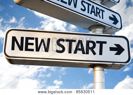 New Start direction sign on sky background