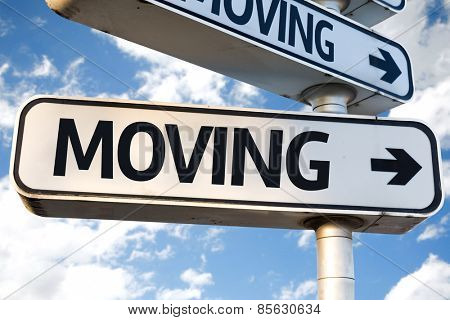 Moving direction sign on sky background
