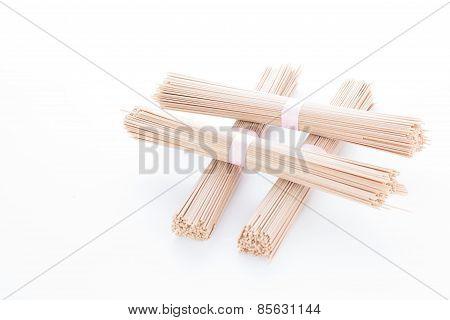 Four Stacked Bundles Of Japanese Buckwheat Soba Noodle; Isolated On White Background