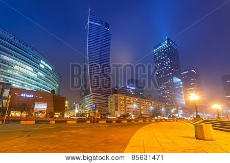 WARSAW, POLAND - 28 FEBRUARY 2014: Skyscrapers in the city center of Warsaw at night, Poland. Warsaw is the capital and largest city of Poland with population estimated at 1,8 million residents.