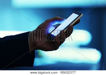 Male hand touching screen phone close-up