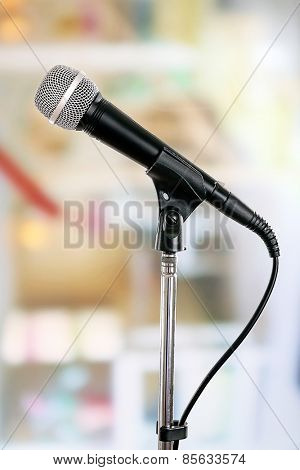 Microphone on stand on light background