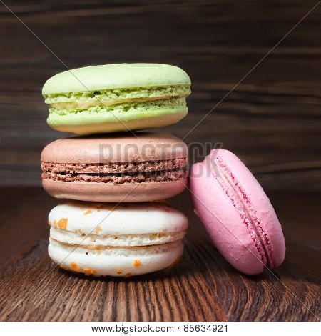 delicious French Colorful macaroons, stacked on table.